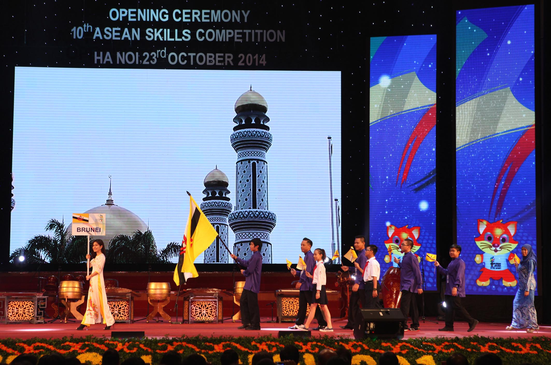 Brunei's delegation parades into stage