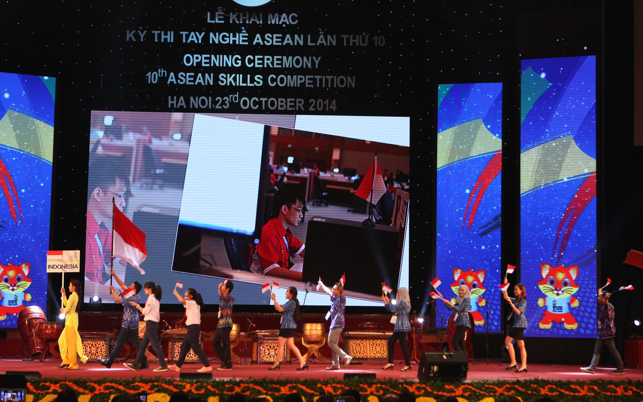 Indonesia's delegation parades into stage