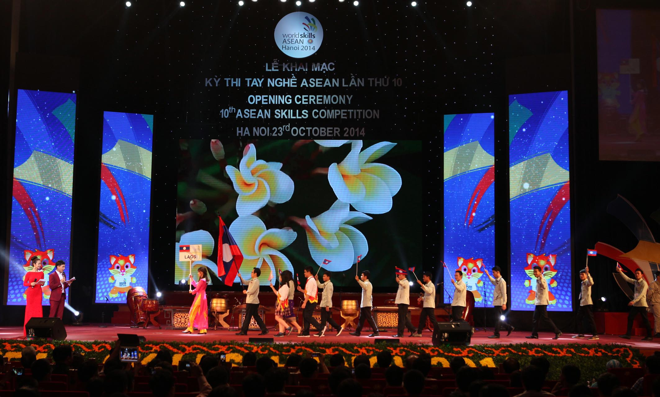 Laos' delegation parades into stage