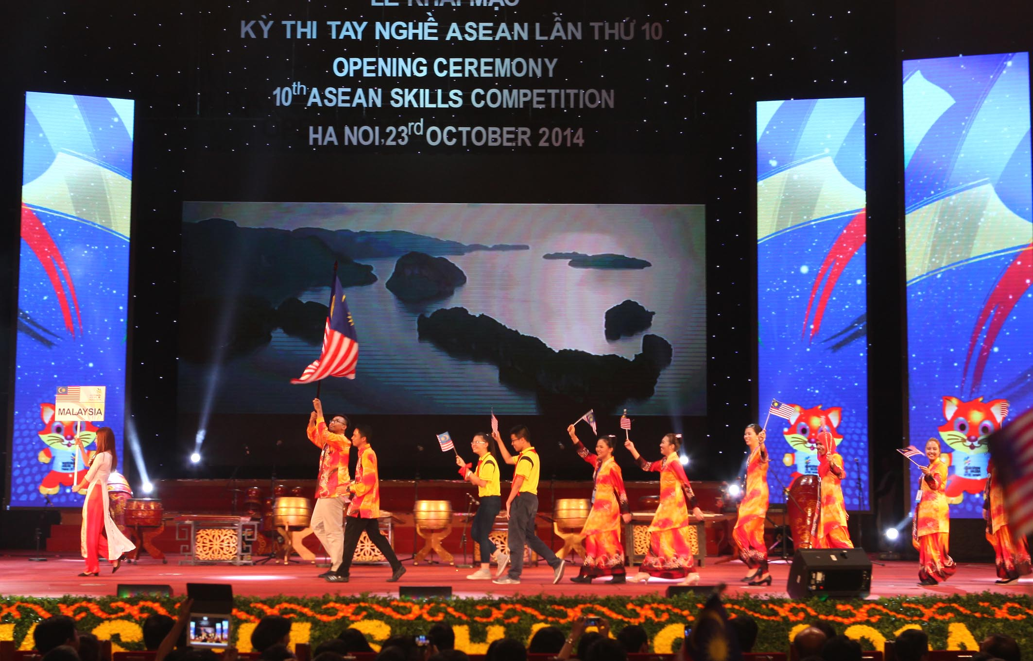 Malaysia's delegation parades into stage