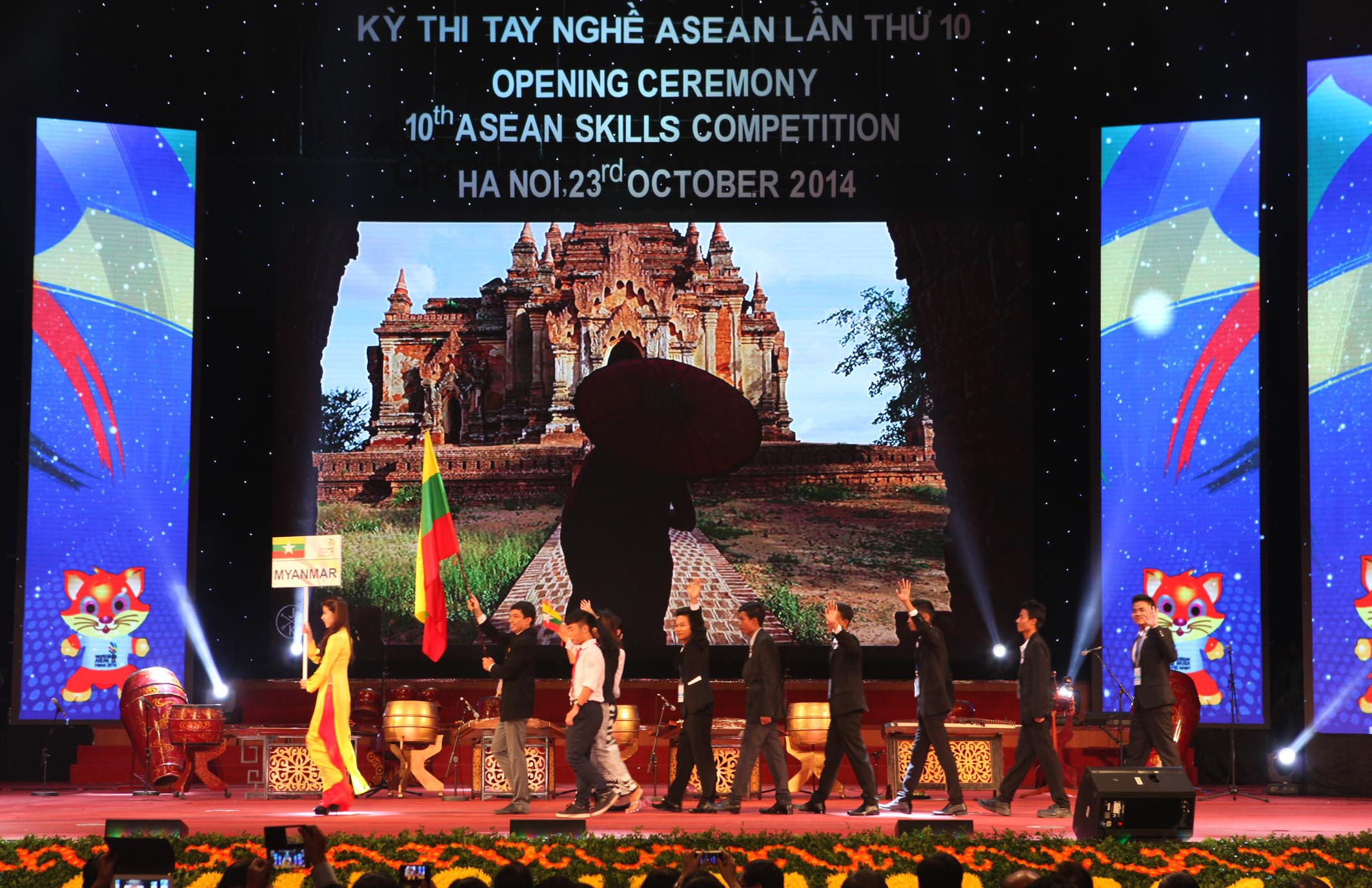 Myanmar's delegation parades into stage