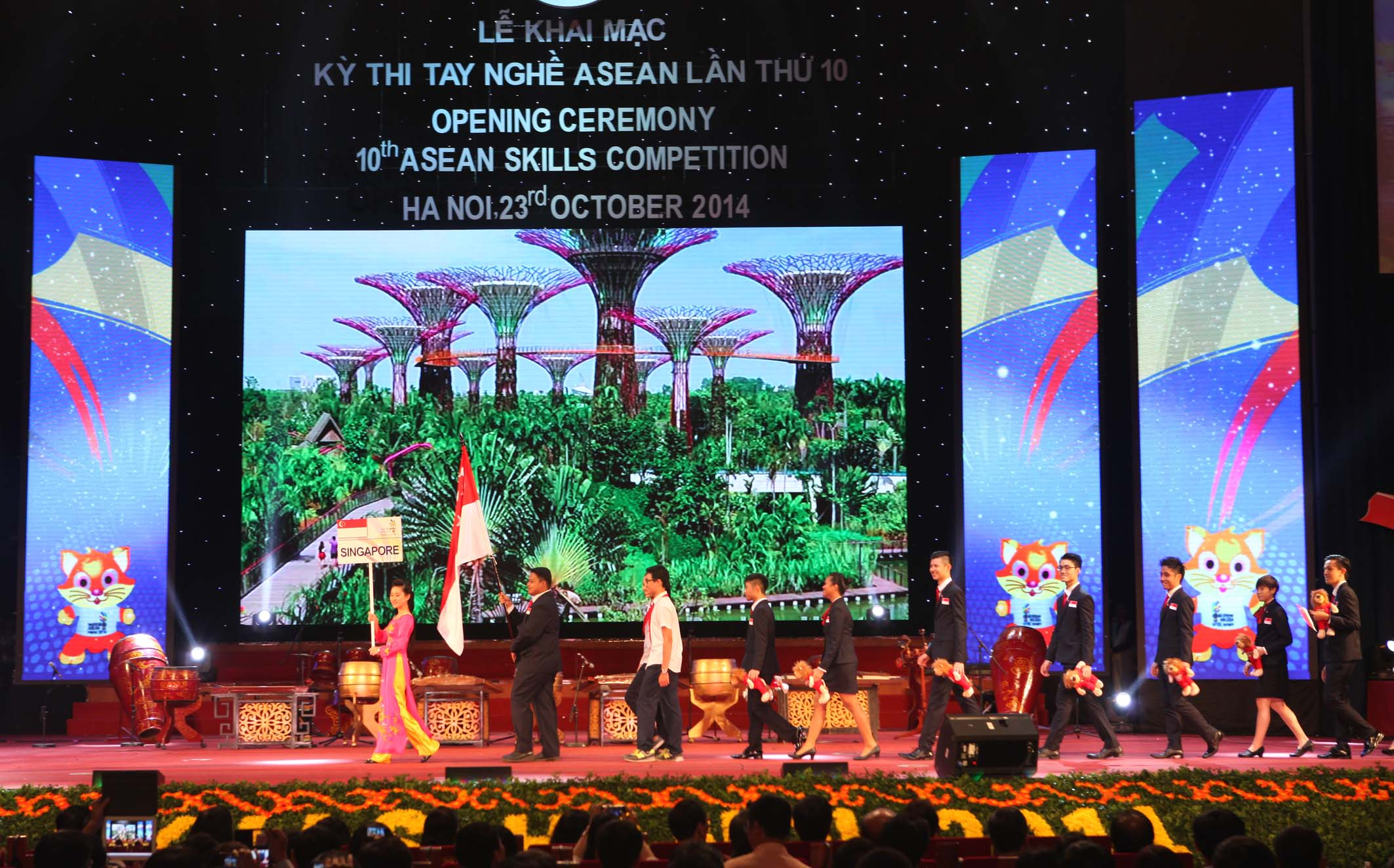 Singapore's delegation parades into stage